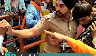 Sikh Police Officer Becomes a Human Shield for a Muslim Boy in India